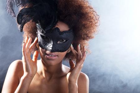 musk: beautiful dark woman with mask