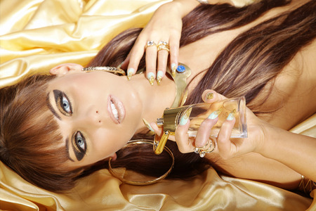 fashion model in cleopatra style and perfume photo