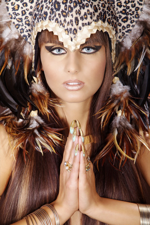 model in cleopatra style and feather headdress photo