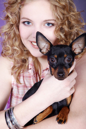 beautiful woman holding a small dog photo