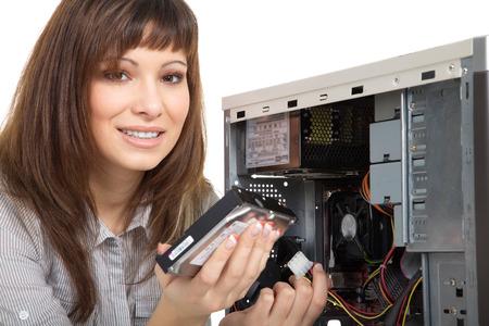 beautiful young woman repairing the computer