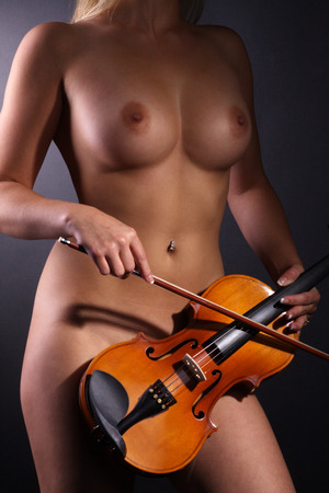 nice breast: nude woman breast with violin