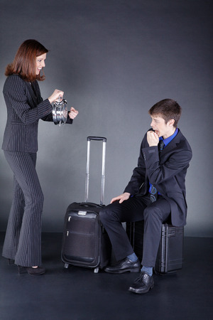 Business couple with suitcase have fun photo