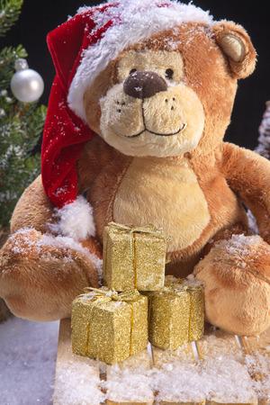 christmas teddy bear riding the sled photo