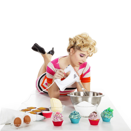young woman in pin up style and cupcake photo