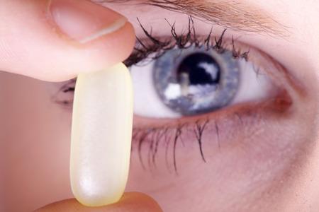 Beautiful woman investigates a capsule photo