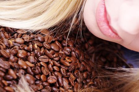 beautiful woman lying on coffee beans photo