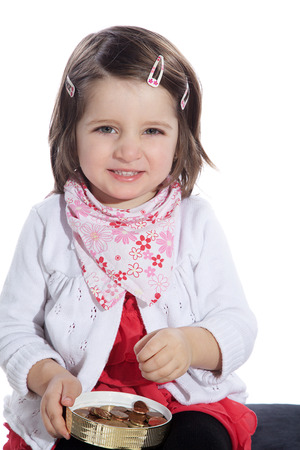 young little girl with lots of money photo