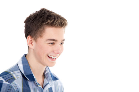cheerfully: young handsome man cheerfully laughs