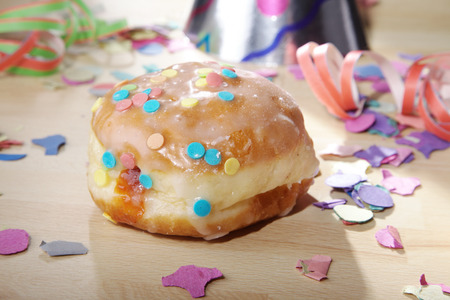 donut decorated with carnival paraphernalia photo