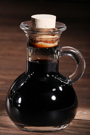 diat product: balsamico in glass on dark