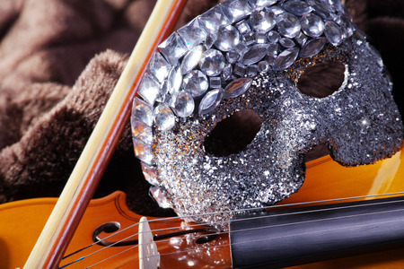 beautiful violin with a mask close up photo