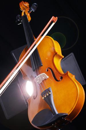 beautiful violin on a black  photo
