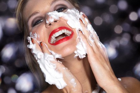 beautiful woman with great makeup and shaving cream photo