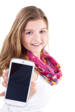 beautiful young woman presents her cell phone photo