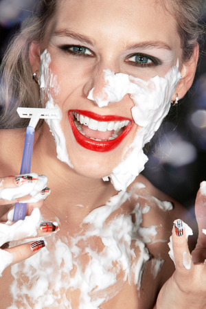 beautiful woman applying shaving photo