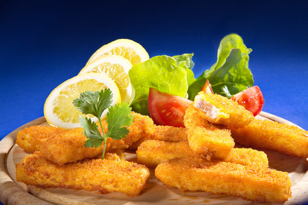 fish fingers on a wooden board photo