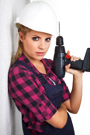 beautiful young woman with a drill photo
