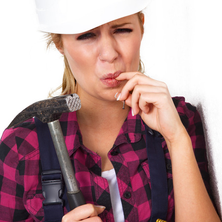 beautiful young woman with a hammer photo