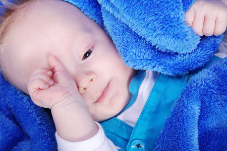 cuddly: beautiful baby in blue towel cuddly Stock Photo