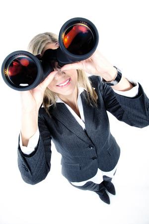 pretty woman looks through a binoculars photo