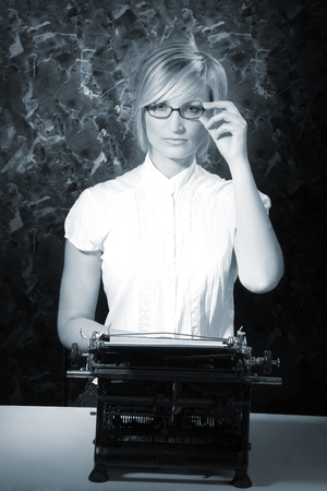 beautiful woman with glasses and old typewriter photo