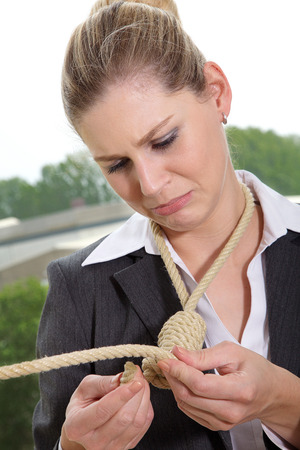 hangs: Business woman on the rope