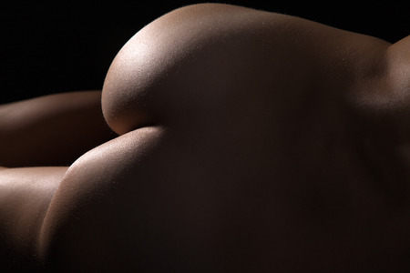 Nude butt of a woman close up