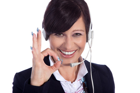 business woman with headset and ok photo