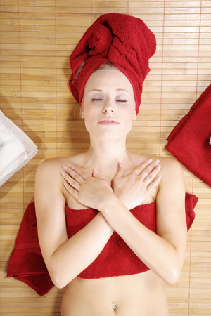 beautiful blond woman with red deco wellness photo