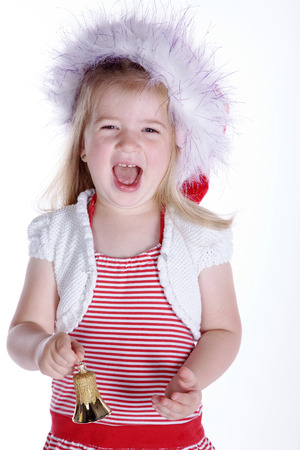 little girl with santa hat and bell photo
