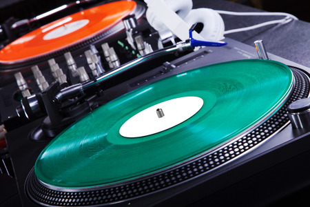 record player with colored vinyl record and headphone photo