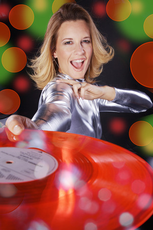 dj woman with colorful vinyl record and smile photo