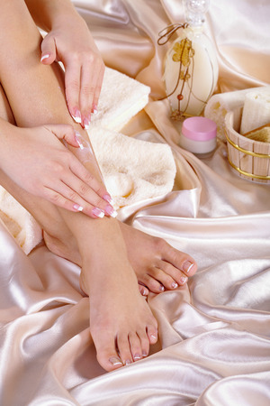 beautiful feet with bathroom accessory photo