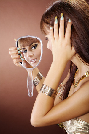 fashion model in cleopatra style and mirror photo