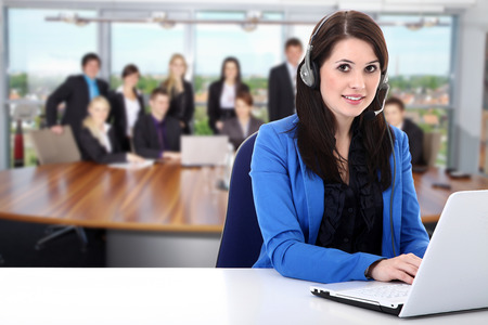 business woman with headset and laptop
