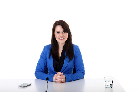 Business woman at the table and microphone photo
