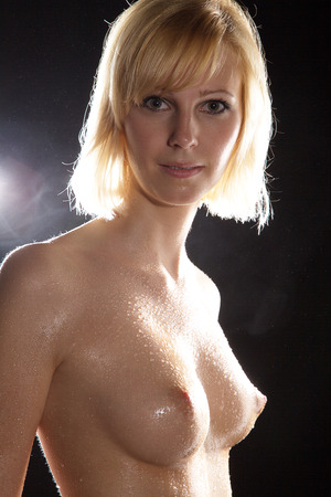 bare breasts: Nude wet female body and water