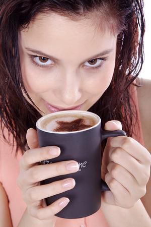 woman drinking coffee with milk foam photo