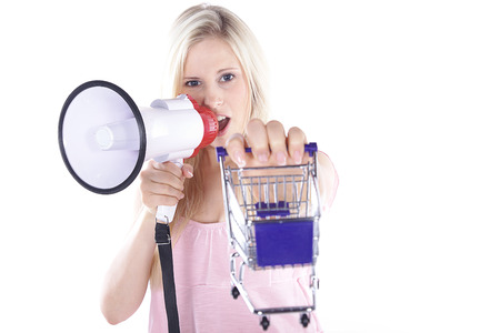 pretty woman with shopping carts and megafone photo