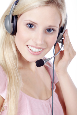 young pretty woman with headphones and thump up photo
