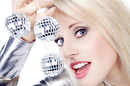 pretty blond woman with disco balls photo