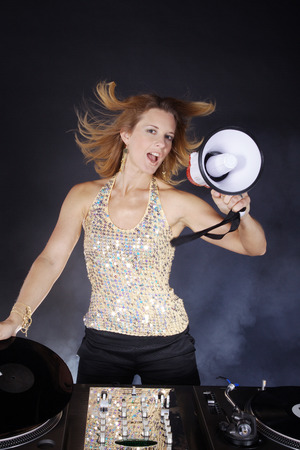 flying hair: dj woman with flying hair record player and magaphone