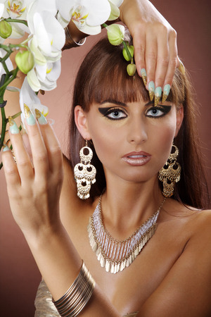 fashion model in Cleopatra style and long nails photo