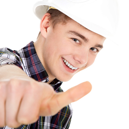 Young construction worker with thump up photo