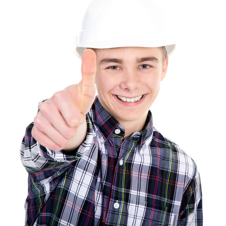 thump: Young construction worker with thump up Stock Photo