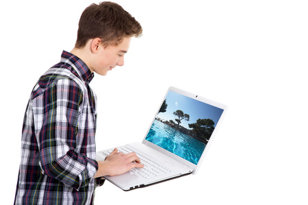 friendly young business man with laptop photo