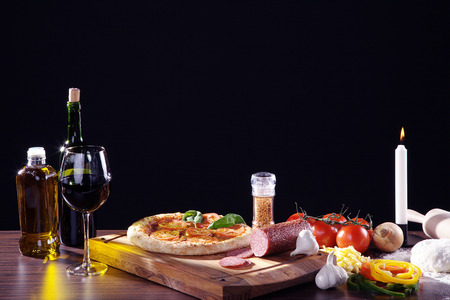 diat product: pizza on wooden cutting board with wine