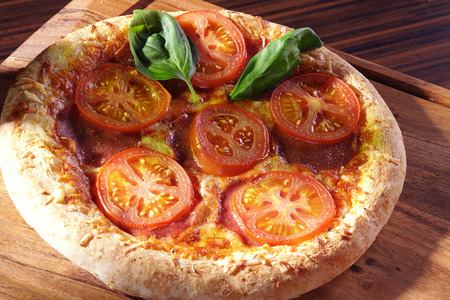 diat product: pizza with tomatoes and basil Stock Photo