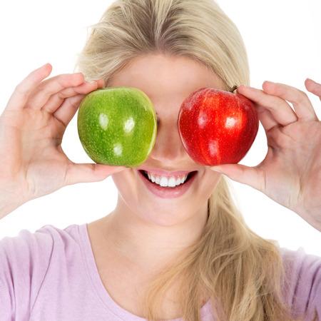 beautiful woman eating a juicy apple photo